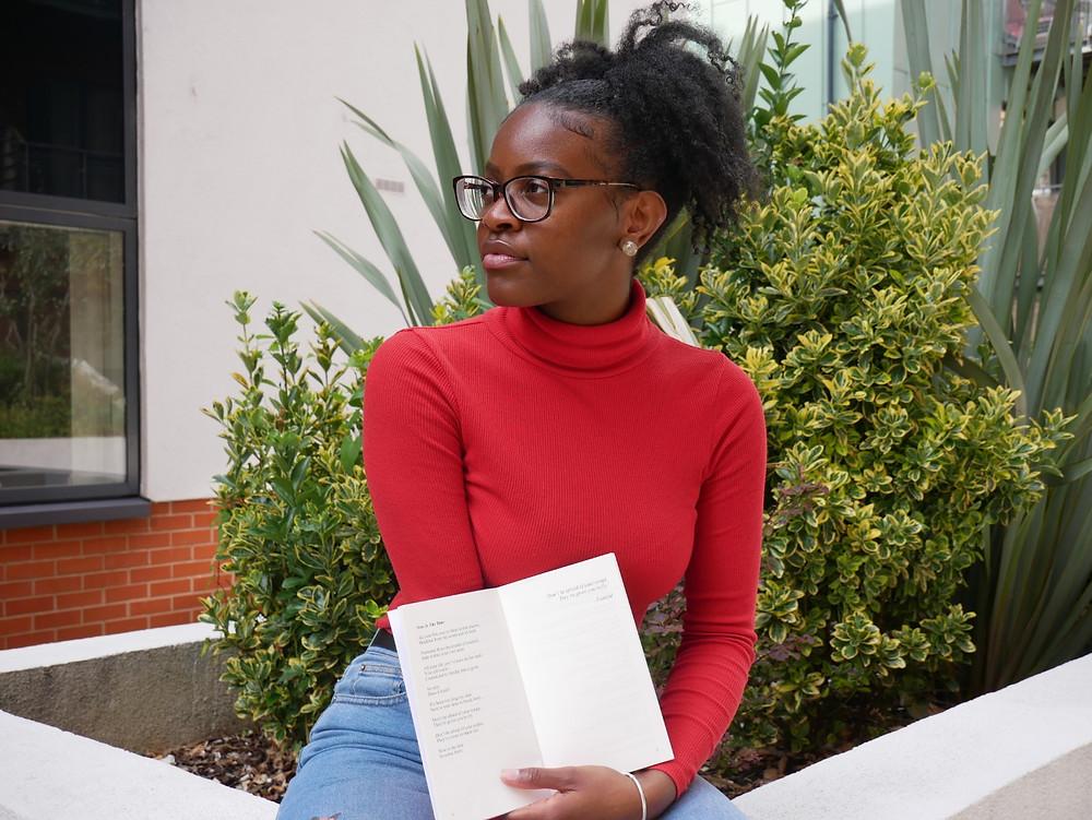 Faith Olajuyigbe with poetry book