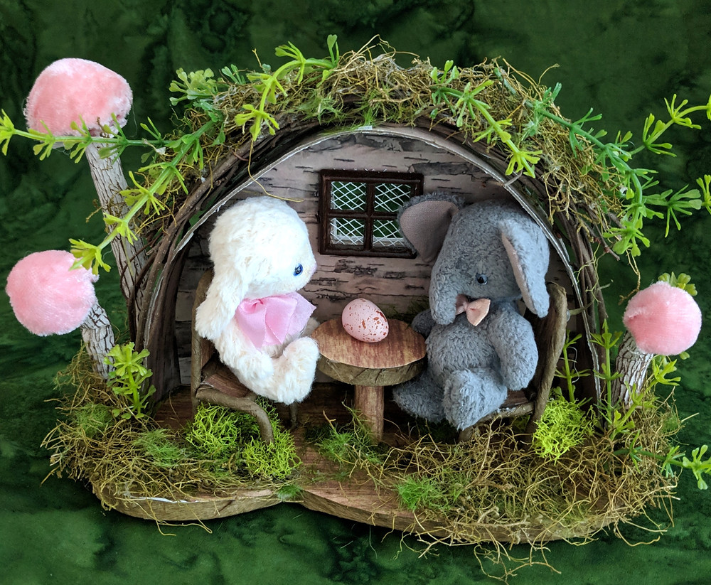 Tiny Matilda the bunny and Lucky the elephant enjoy planning their Easter celebrations as they sit in their garden kitchen from Michaels craft supply store.