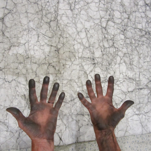 Graphite on  hands