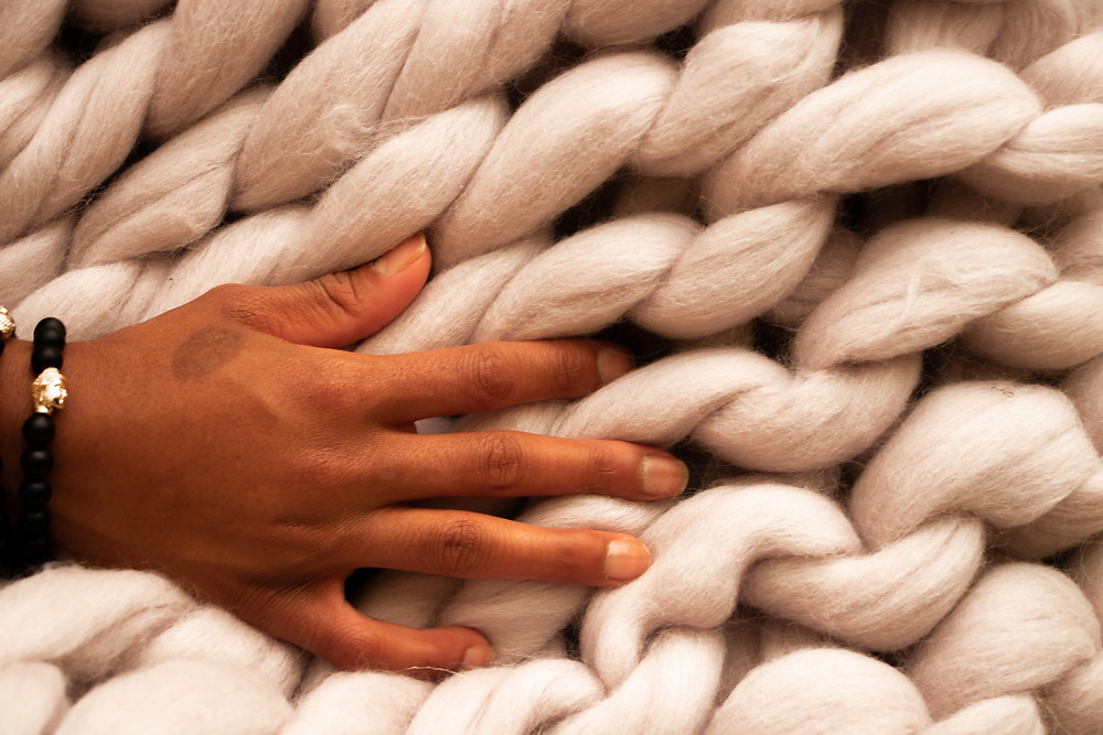 hand on thick wool knit blanket
