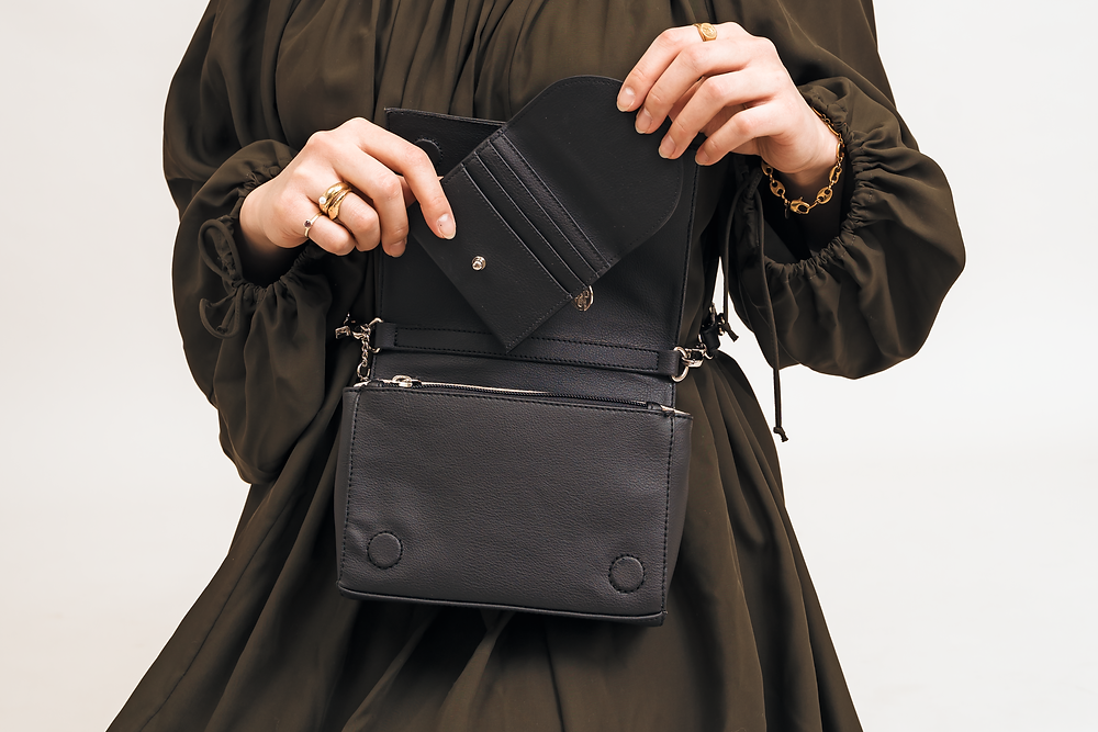 woman wearing a vegan leather bag and coin purse
