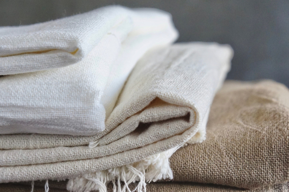 a stack of folded linen cloth