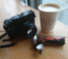 A picture of my camera a cup of coffee and a mars bar