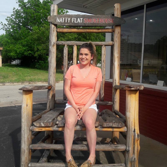 Girl Sitting in Outdoor Oversized Rocking Chair