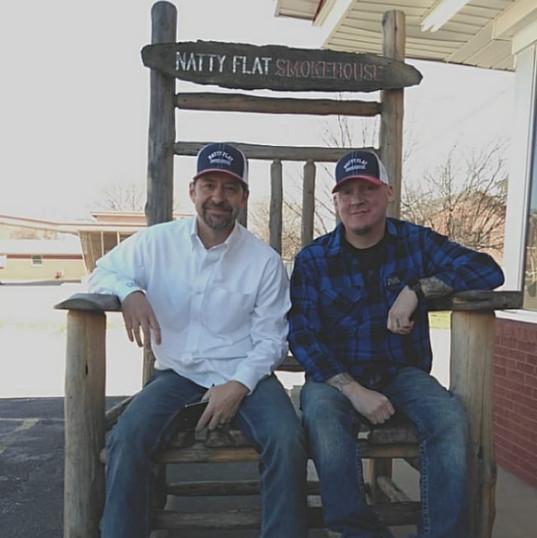 2 Men Sitting in Outdoor Oversized Rocking Chair