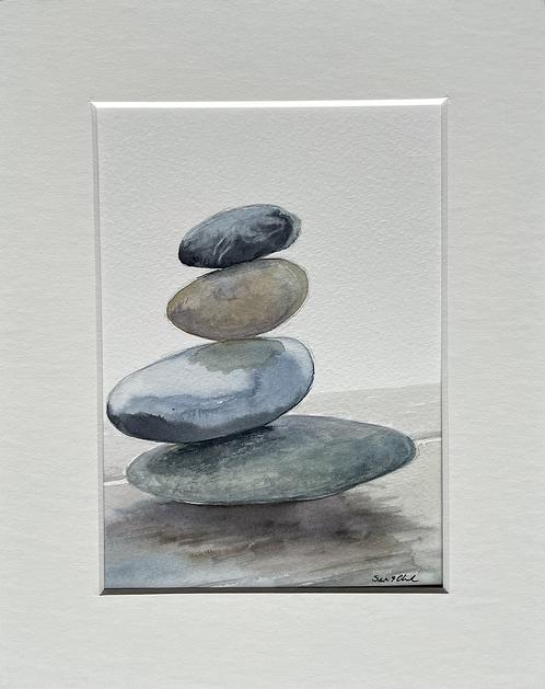 Rock stack balancing act