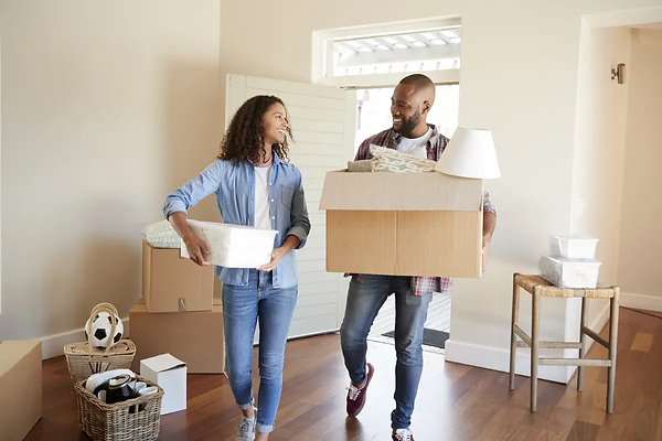Couple-Carrying-Boxes-Into-New-Home-On-M