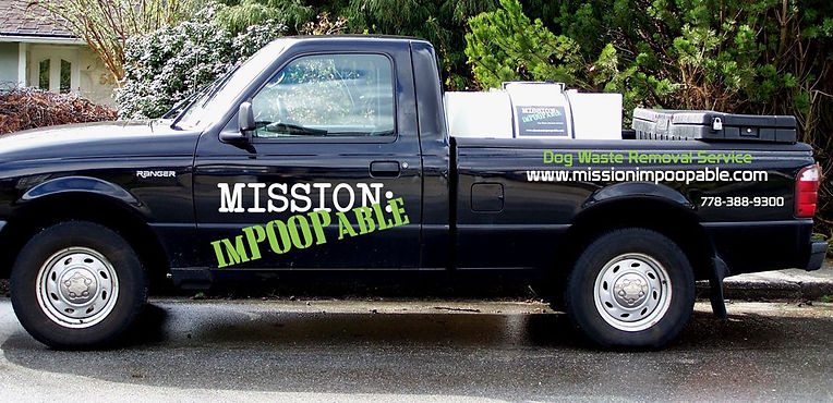 a black pickup truck with the words Mission: Impoopable and dog waste removal service on the side