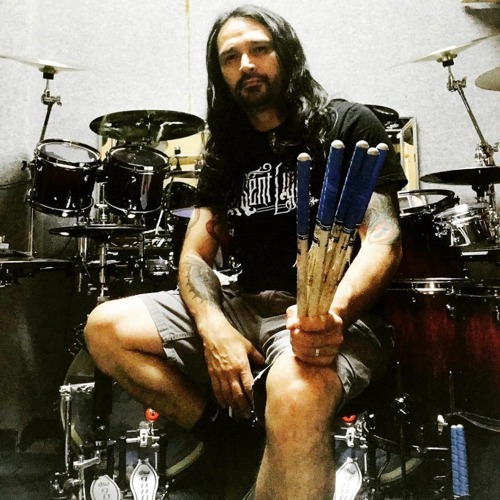 Aquiles Priester with The Absent Light Logo