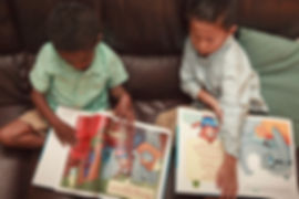 two kid reading Riley the Brave Book