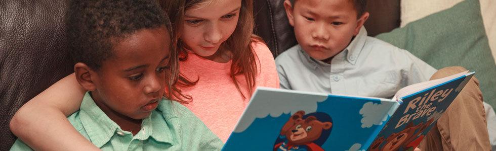 Kids reading Riley the Brave