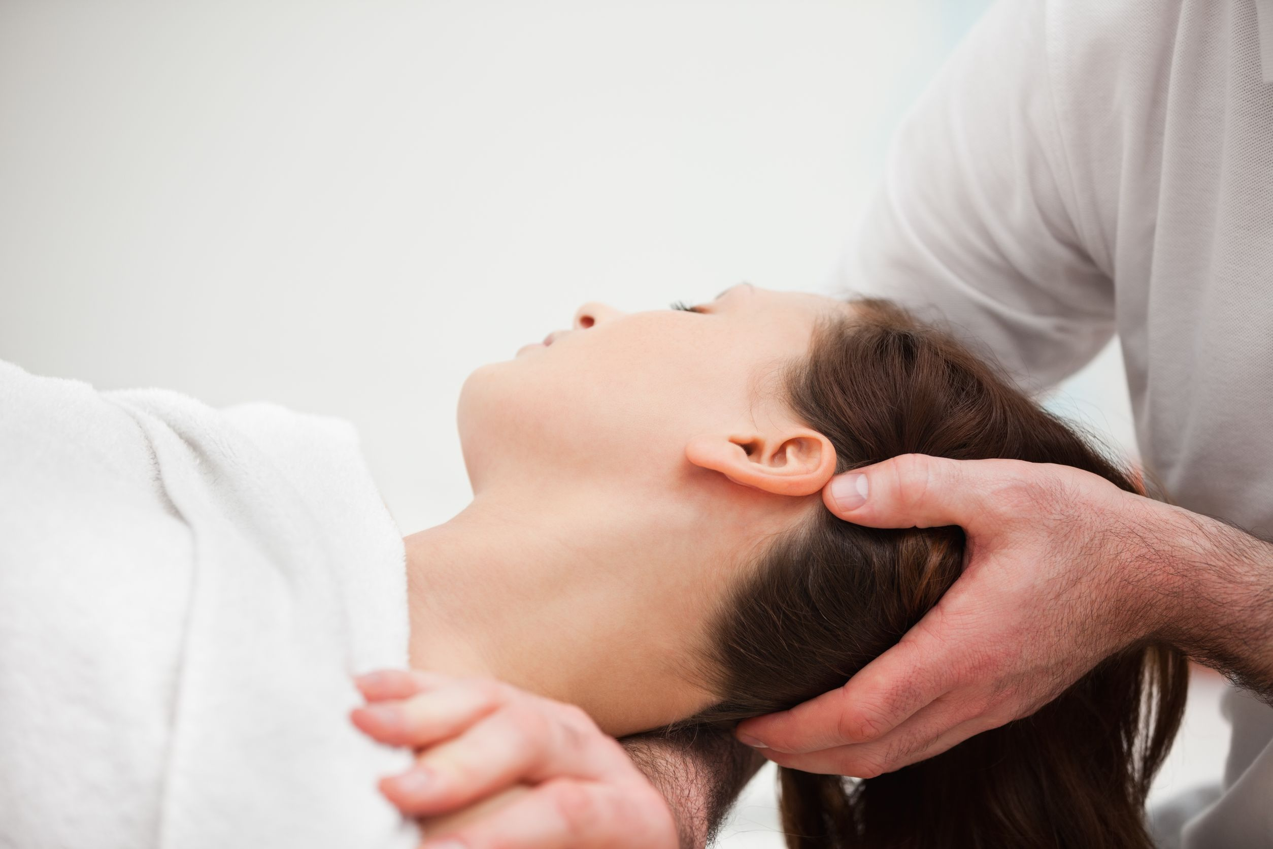 osteopathy procedure manipulating the neck of a woman