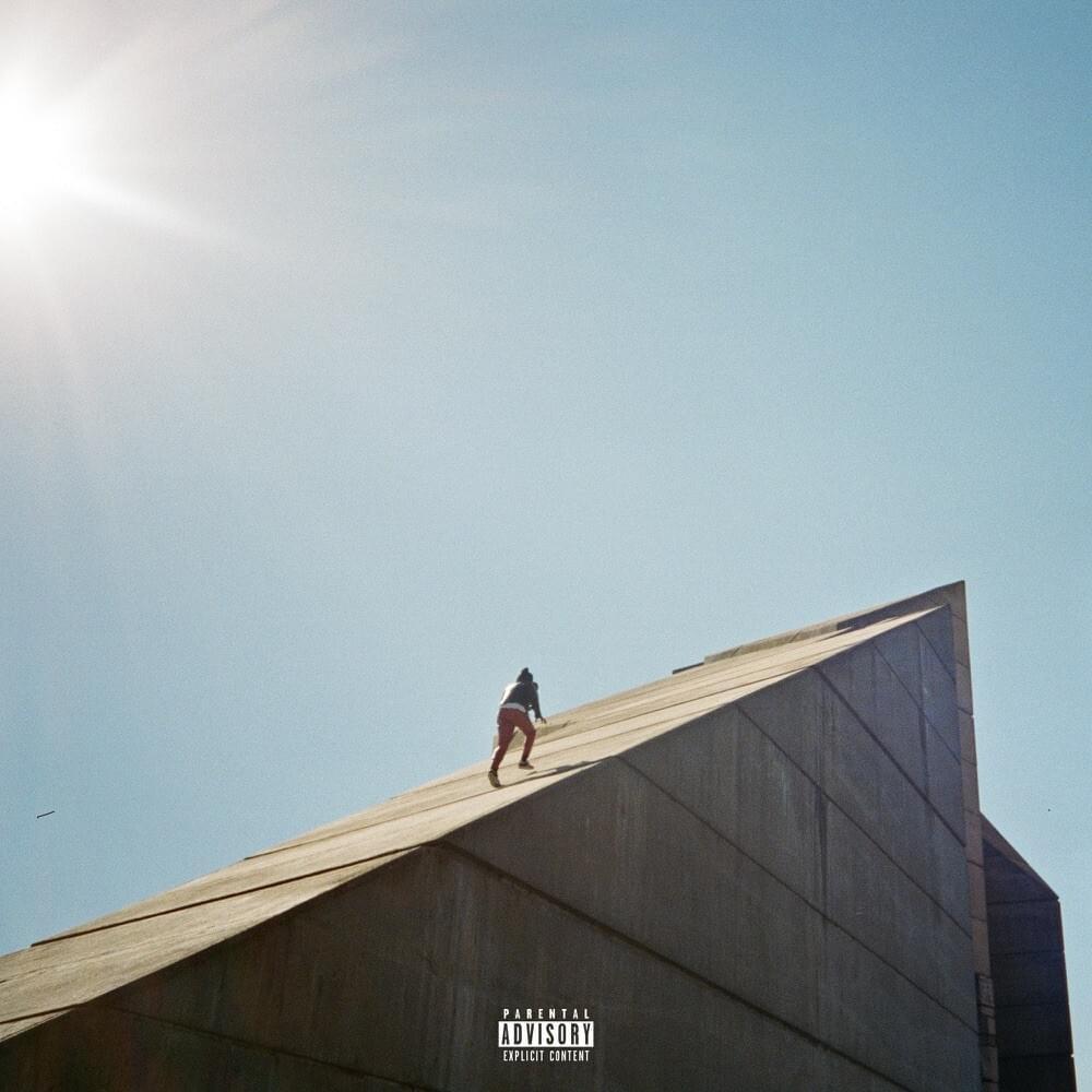 man climbing steep summit in Freudian album cover