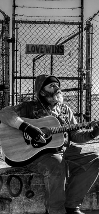 black and white image of man with guitar