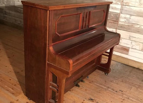 Ritmuller Arts and Crafts rosewood upright piano