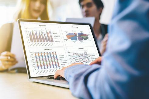 team working-laptop charts.jpeg
