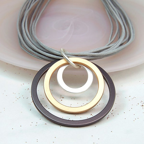 Mixed metallic hoop and multistrand grey cord necklace