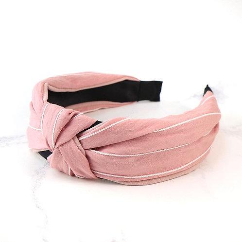 Pink fabric headband with fine white stripes