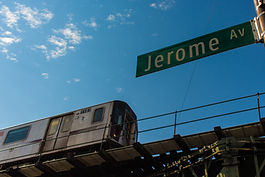 Jerome Avenue street sign with elevated subway in background