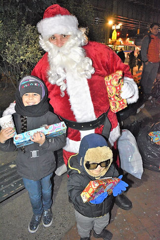 Kids with Santa at Jerome Gun Hill holiday tree lighting