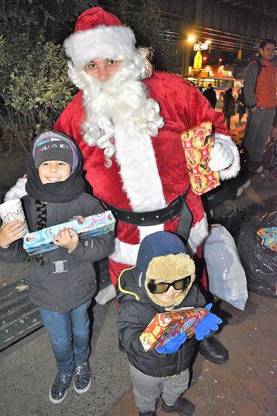 Kids with Santa at Jerome Gun Hill holiday tree lighting