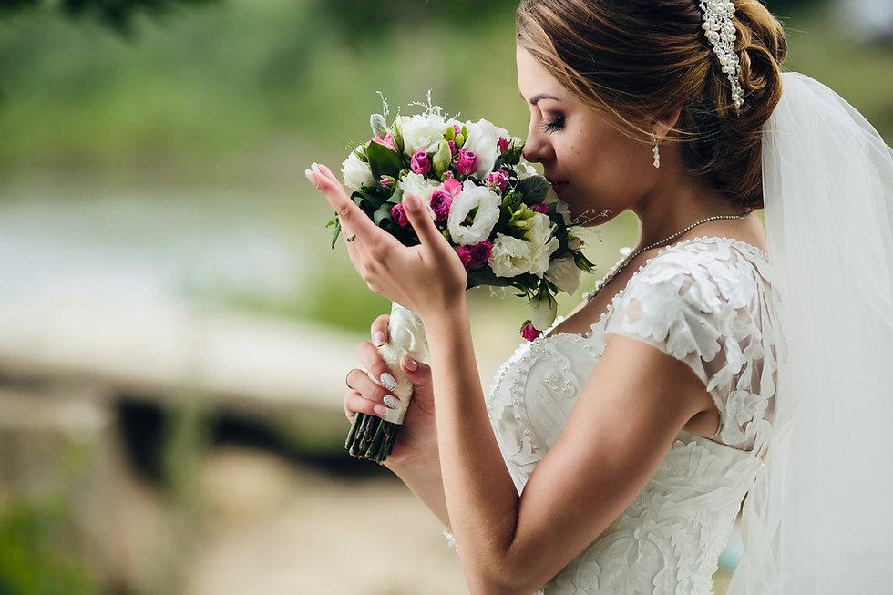 pretty-bride-smelling-flowers.jpg