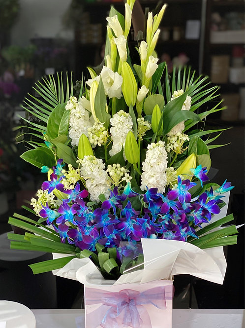Deluxe size white and blue box arrangement