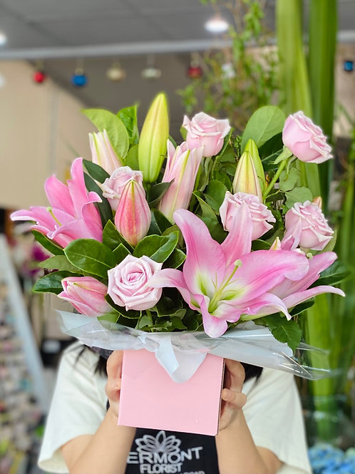 Pink oriental lily with pink roses