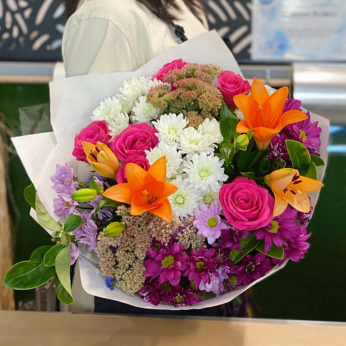 Designer choice seasonal bouquet (5 to 7 types of flowers)