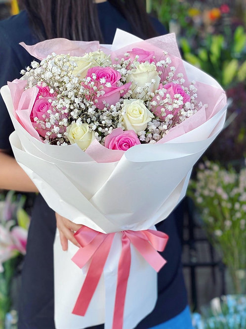 Blushing love (dozen pink and white mix rose with baby's breath)