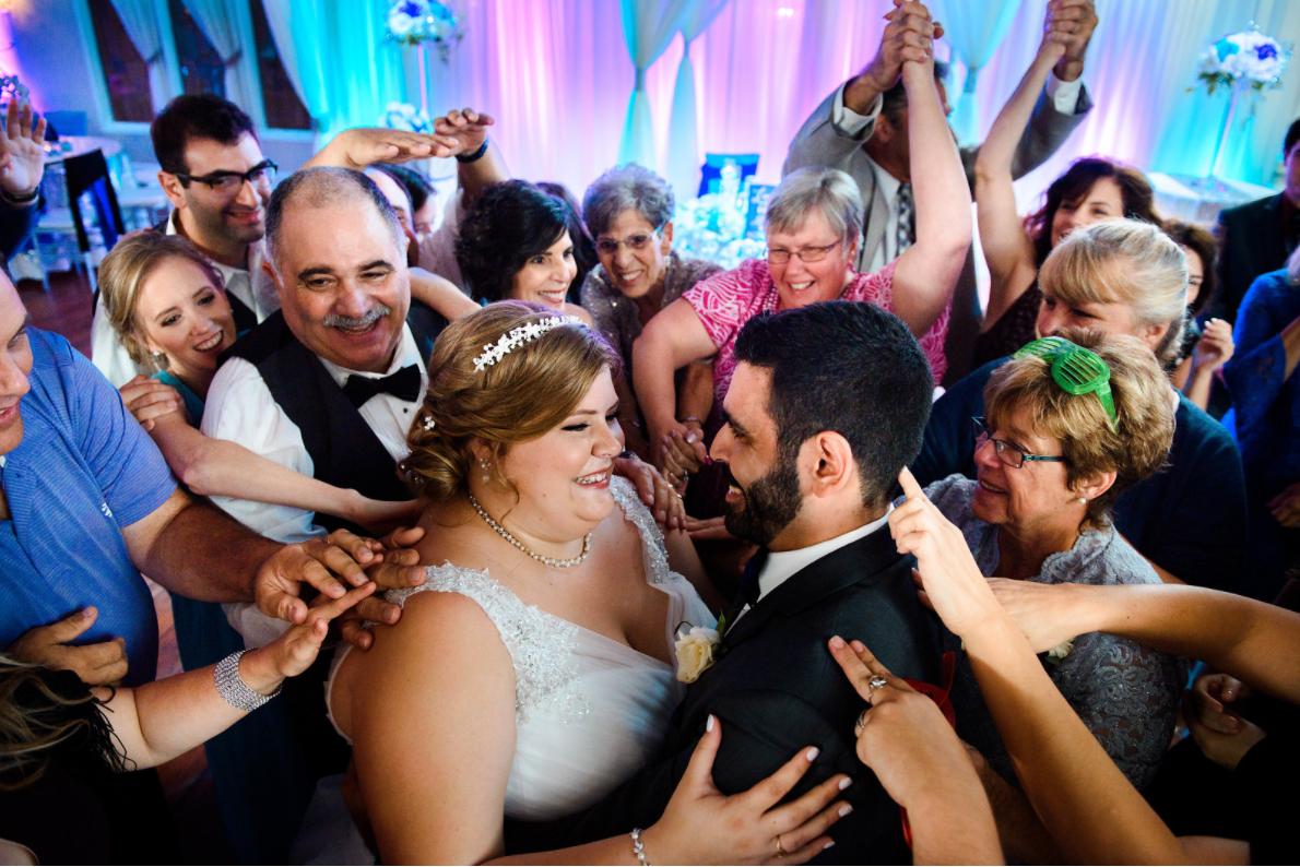 Bride and Groom Dancing on Danc Floor at Wedding