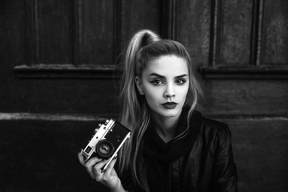girl-with-retro-camera-picture-id6127378