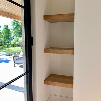 62 Screws custom White Oak floating shelves made and installed locally in Milton, Georgia