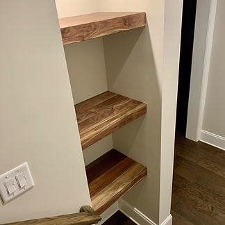 62 Screws custom Walnut floating shelves made and installed locally in Alpharetta, Georgia