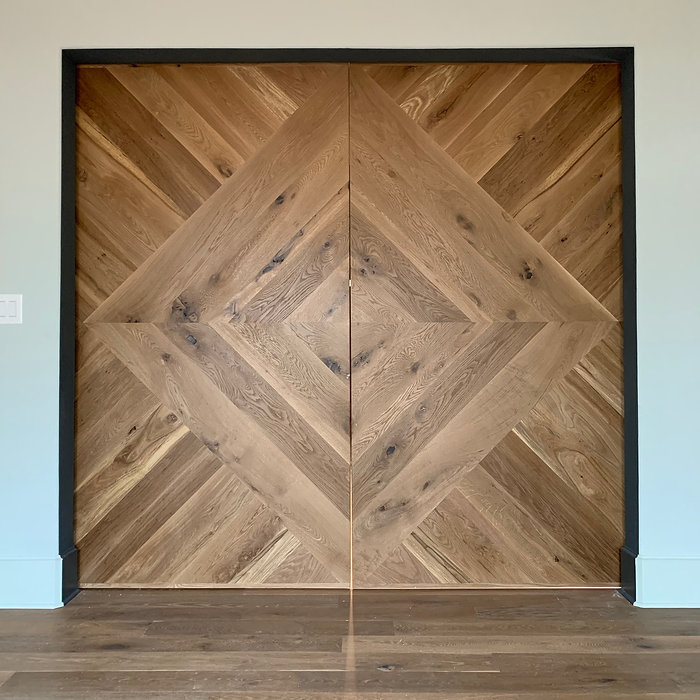 62 Screws custom White Oak chevron pattern barn doors with black hardware made and installed in Roswell, Georgia