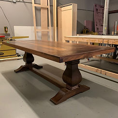 62 Screws modern farmhouse custom Walnut trestle dining table made in Roswell, Georgia