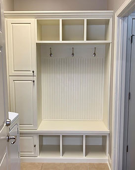 62 Screws custom hardwood white mudroom built-in with bench storage, silver hardware, shiplap, similar to Pottery Barn.