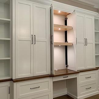 62 Screws premium hardwood office built-in with an oversized desk, custom lighting, and cabinet storage in North Atlanta