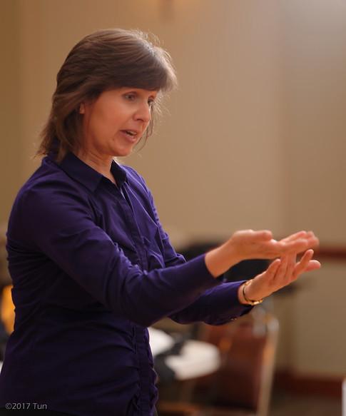 Co-conductor Oksana Rodak in rehearsal.