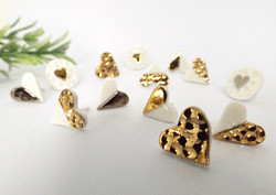 Porcelain and gold hammered heart studs.
