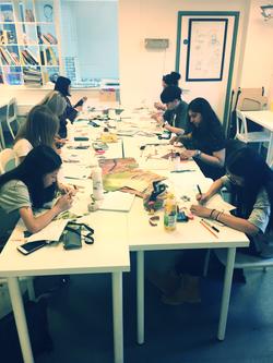 Craft students designing.