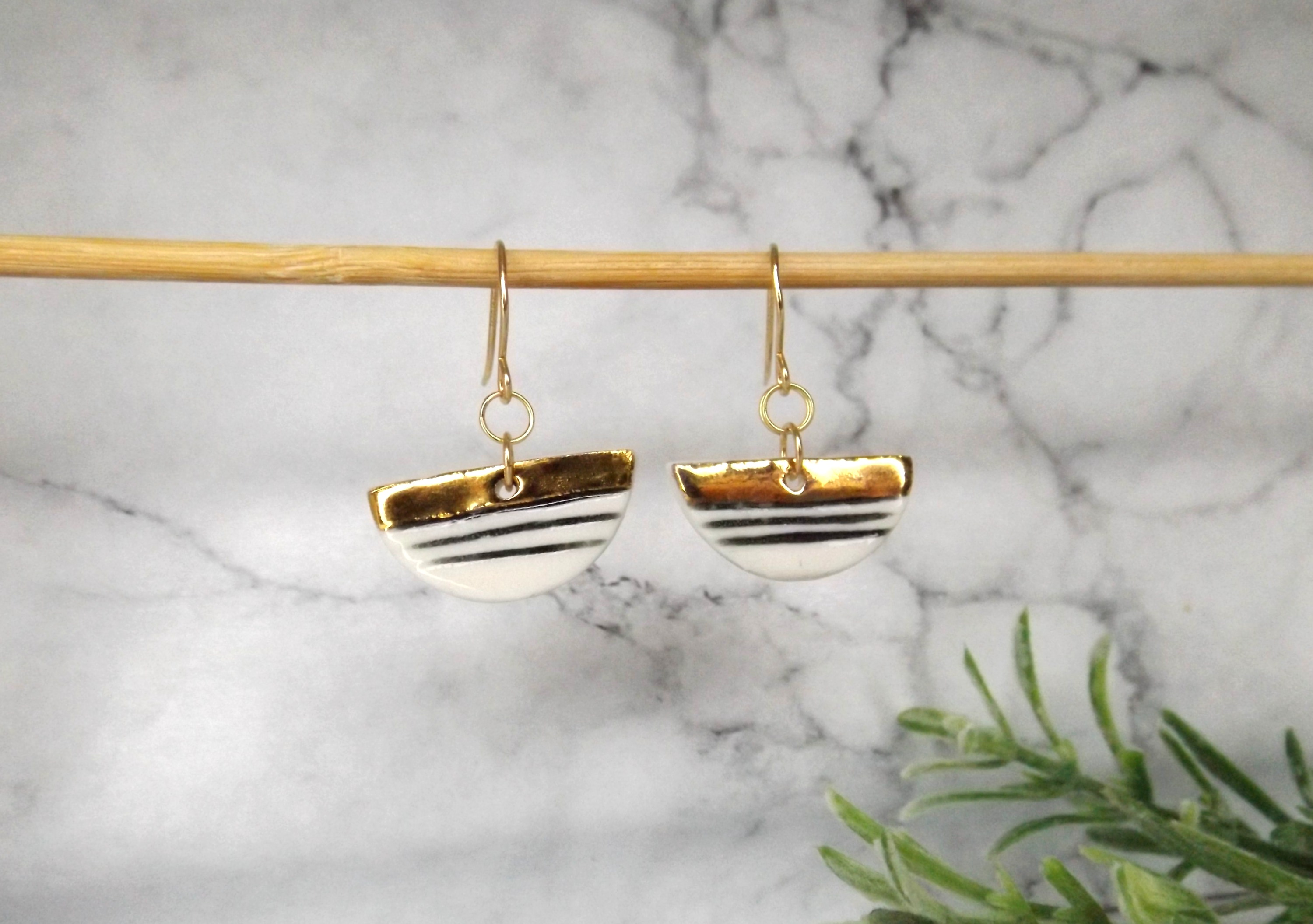 Porcelain and gold contrast, semi-circle earrings.