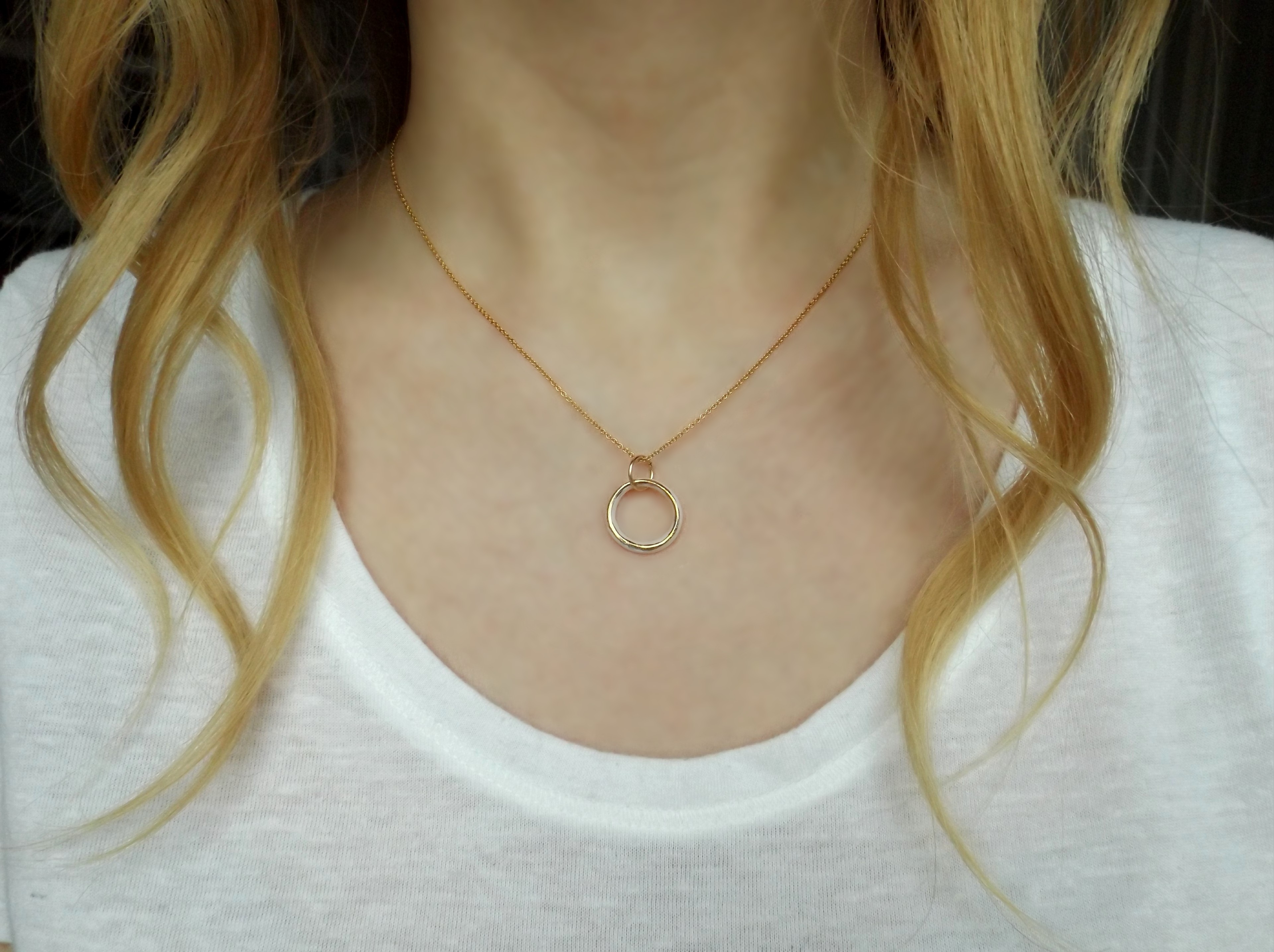 Porcelain and gold ring necklace.