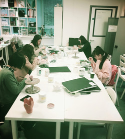 Craft students glazing ceramics.