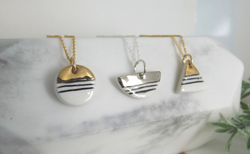 Porcelain and gold or platinum contrast necklaces.