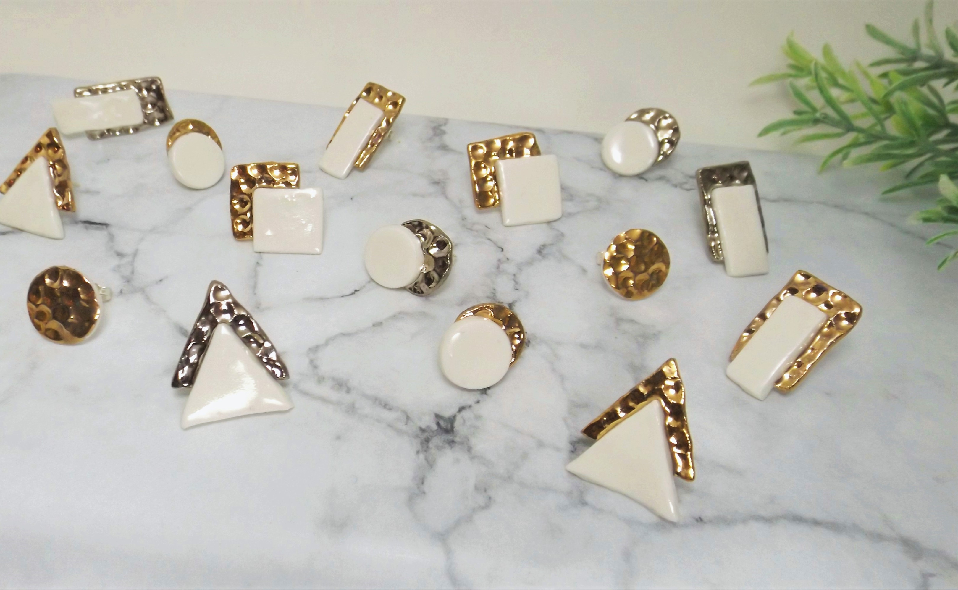 Porcelain and gold or platinum hammered studs.