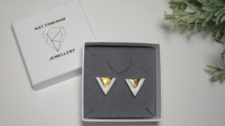 'Lucky' studs - triangle with 'V'.