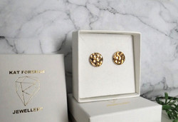Porcelain and gold studs.