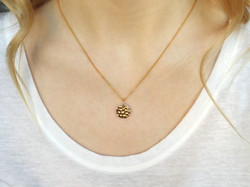 Minimalist, hammered gold effect necklace.