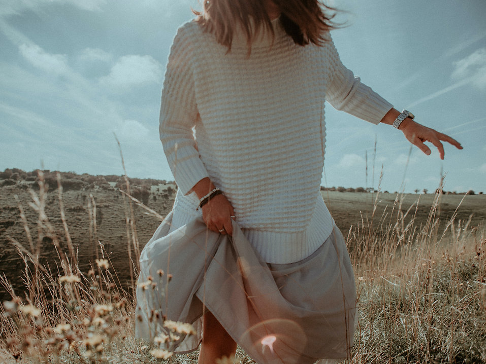 woman-wearing-white-sweater-and-beige-sk